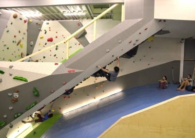 huge roof indoor bouldering gym people climber